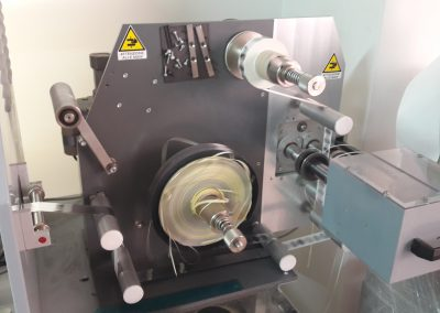 Riavvolgitore industriale 300mm con taglio longitudinale